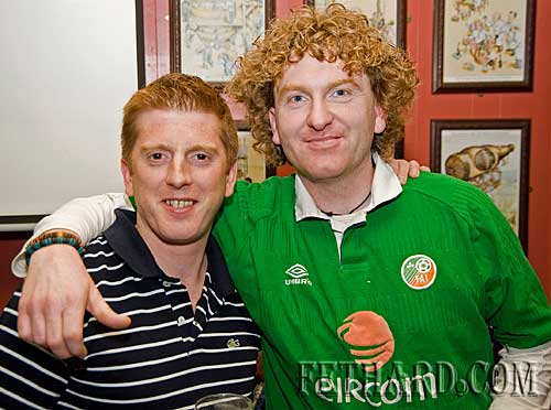 L to R: Dathie Maher and Michael Maher cheering on the Ireland soccer team on thire first leg against France last Saturday night.