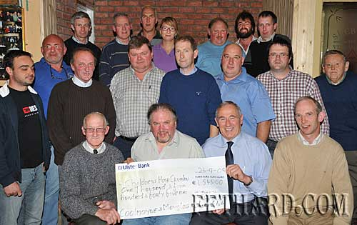 Coolmoyne & Moyglass Vintage Club presentation a cheque for €1,545 to Mick Fahey, representing National Childrens Hospital, Crumlin. Back L to R: Joe Walsh, Pat Kennedy, Eddie Murphy, Carla Blake, Charles McCarthy, Lar Fanning, Ray Walsh. Middle L to R: Mossy Blake, Declan Walsh, Hugh O'Donnell, M.G. Ryan, John Slattery, Michael Trehy, Sean Dunne, Henry Smyth. Front L to R: Michael O'Neill, Pat O'Loughnan, Mick Fahey (representing National Childrens Hospital, Crumlin) and Seamus Barry.
