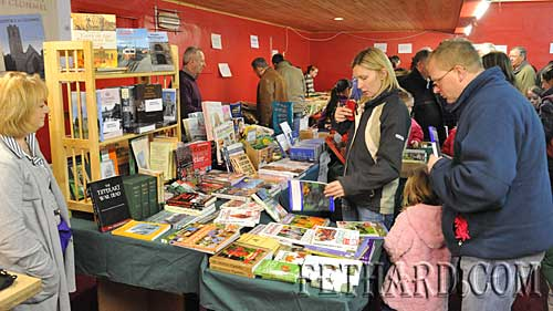 Deirdre Brady Smith and Jimmy Smith looking at books at the Tipperariana Book Fair on Valentine's Day in Fethard Ballroom.