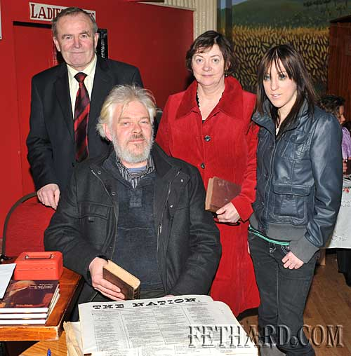 Liam Noonan selling limited copies of 'The Nation' at the Slieveardagh Rural Development stall at the Tipperariana Book Fair in Fethard Ballroom. Also included standing L to R: are Cllr John Fahey, Mally Noonan and Vicky Moore.
