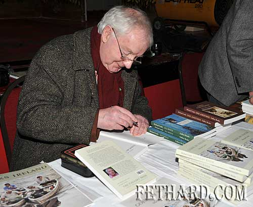 Poet and author, Michael Coady from Carrick-on-Suir, signing copies of his recent publication 'Going by Water' at the Tipperariana Book Fair.