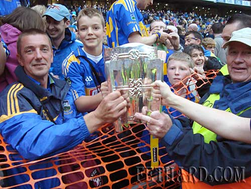 Joedy Sheehan and his dad Tommy, Woodvale Walk, Fethard, holding the Liam McCarthy cup after Tipperary's fantastic victory over Kilkenny in the All-Ireland Hurling Final played in Croke Park on Sunday 5th September.