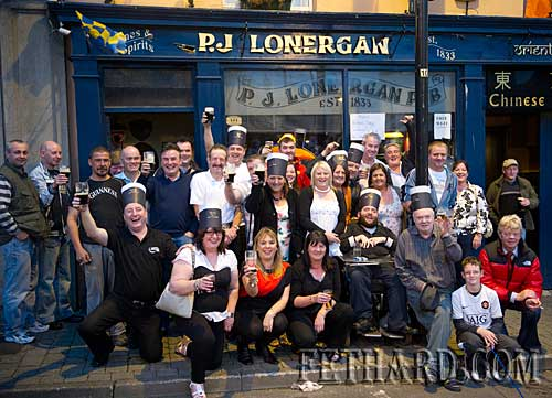 John Carroll and customers photographed in Lonergan's Bar celebrating 'Arthurs Day'