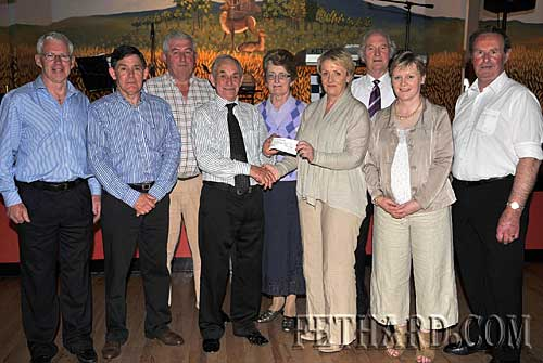 Fethard Ballroom and Dancing Club members presenting the proceeds from the  Mick Aherne Perpetual Trophy Dance Competition held in Fethard Ballroom. The total amount raised was €1,450 which was presented to South Tipperary Hospice at Fethard Ballroom dance on Sunday night. L to R: Robert Phelan, Pat Kirwan, Pat Ryan, Billy Corcoran (Thursday Night Dancing Club), Monica Aherne, Phil Kehoe (South Tipperary Hospice), Tony Marshall, Majella O'Donoghue and Gay Horan (Chairman Fethard Ballroom Ltd).