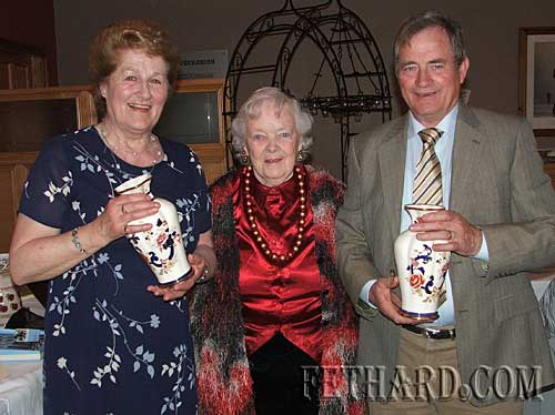 Kathleen Kenny (centre), President of Fethard Bridge Club, presenting 'President's Prize' to winners Nell Broderick and David O'Meara.