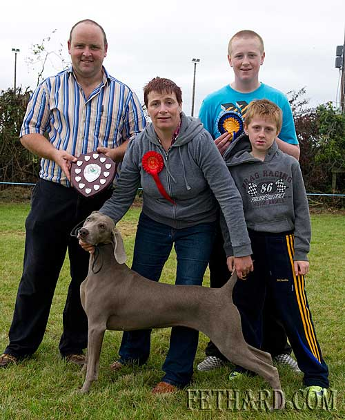 Theresa Hurley photographed with her one-year-old Weimaraner dog who was chosen as 'Best in Show' at Fethard Community Family Field Day 'Dog Show' sponsored by Moyglass Kennels. L to R: John Smullen (Moyglass Kennels), Theresa Hurley, Eoghain Hurley and Darragh Hurley.