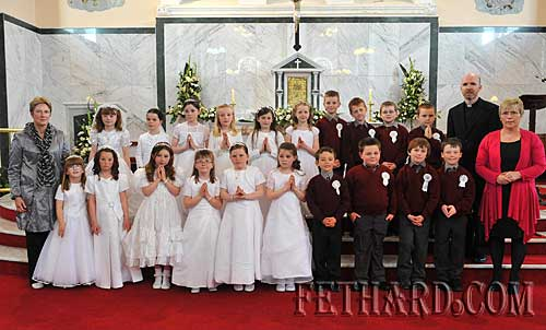 Boys and girls from Fethard who received the Sacrament of First Holy Communion on Saturday 8th May. Children are Ashley Bradshaw, Emma Jane Burke, Sarah Carroll, Megan Earl, Margaret Fitzgerald, Megan Hackett, Laura Kiely, Chloe Nolan, Rachel Prout, Andrea Pyke, Sinead Regan, Lucy Spillane, Darragh Hurley, Eric Costin, Aaron Trehy, Adam O'Sullivan, Andrew Phelan, Richard Anglim, Robert Hackett and Ben Murphy. Also included are Fr. Anthony McSweeney, and teachers Ms Maureen Maher (Nano Nagle National School) and Ms Patricia Treacy (St. Patrick's Boys School).