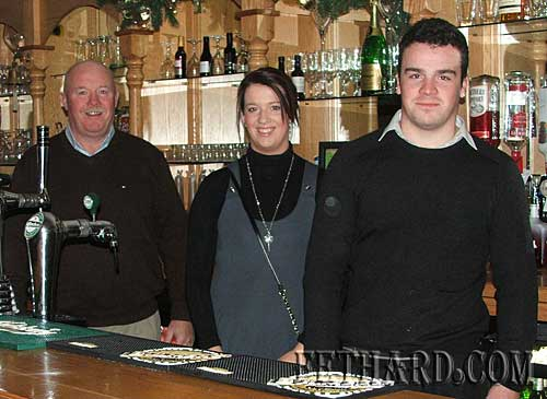 Bar Manager, John Lonergan (left), photographed with his son Conor and daughter Rachel at Bunkers Bar, Slievenamon Golf Club.