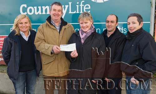 Glanbia staff members at their Fethard branch presenting a cheque for €12,000 to South Tipperary Hospice Movement. L to R: Freda Hayes, John O'Flynn (Area Manager), Majella O'Donoghue (South Tipperary Hospice), Eamon Holohan (Fethard Branch Manager) and Noel Morrissey.