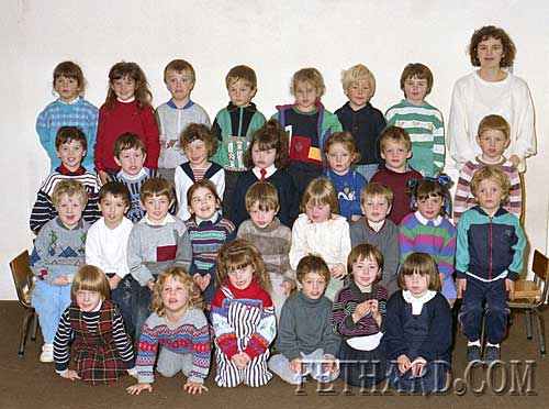Fethard Nano Nagle School Junior Infants Class, October 1989. Back Row L to R: Vanessa O'Donnell,Woodvale Walk; Kersty McCarthy, Kerry St.; Emmet Burke, Redcity; John Conway, St. Patricks Place; Ailish O'Connell, Coolmoyne; Paul Fogarty, Woodvale Walk; Ursula Lawrence, Woodvale Walk; Margaret Gleeson (teacher). Third Row: Kevin Lawlor,St. Patricks Place; Kevin O'Connell, Coolmoyne; Tara Ryan, St. Patricks Place; Tara Mullins, St. Patricks Place; Helena McCormack, Kerry Street; David Coughlan, Rocklow Rd.; Christopher Doyle, Woodvale Walk. Second Row L to R: Lar Looby,Woodvale Walk; Aaron Kelly, Drumdeel; Mark Hayes, Rathcoole; Anne-Marie Connolly, Main St.; Darren O'Meara, Woodvale Walk; Gillian Shine, Congress Tce.; Jamie McCormack, Woodvale Walk; Evelyn O'Connor,St. Patricks Place; Nicky Noonan, St. Patrick's Place. Front Row: Stacy Joy, Redcity; Gavin Ahearn, Monroe; Sabrina O'Dwyer, Woodvale Walk; Vincent Taylor, Rocklow Road; Emer Fogarty, The Green; Jodie Gilpin, The Valley. Absent from photograph: Wayne O'Driscoll, Rocklow Road; Richard Sayers, Woodvale Walk; Jim Ryan, Grove Road; Killian Cannon, Ballintemple; Aoife O'Meara, Spittlefield; and Michelle Coffey, Grove Road.