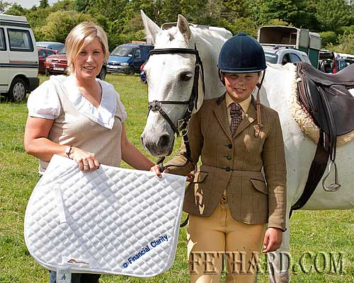 Hanna Philips with her horse 'Ballyvaden Here we go again' receiving the her prize for Reserve Champion Working Hunter from Peggy Burke (left)