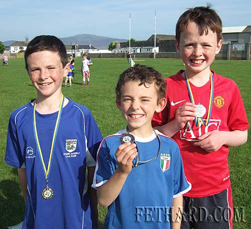 L to R: Conor Harrington, Robert Hackett and Peter Wall who all won medals at Fethard and Killusty Community games athletics.