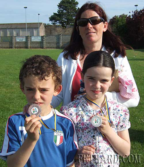 The Hackett twins, Robert and Megan, who both won medals at Fethard and Killusty Community games athletics photographed with their mum Noreen