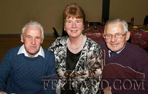 Photographed at the Moyglass Christmas Party in their new Community Hall. L to R: Tommy O'Brien, Mary O'Brien and Michael Moloney.