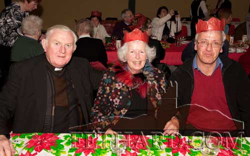 Photographed at the Moyglass Christmas Party in their new Community Hall. L to R: Canon Liam Ryan, Mrs Evie Stockwell and Michael O'Sullivan