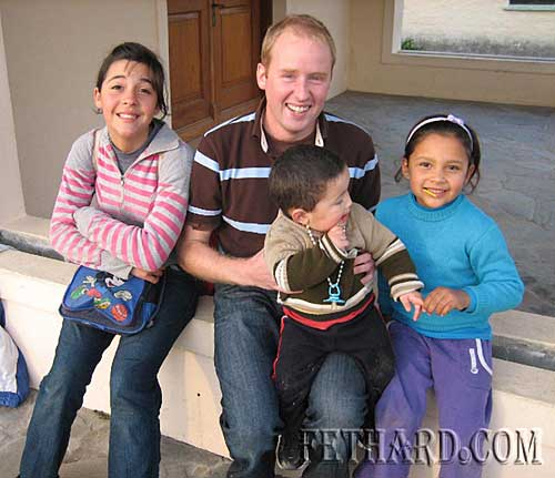 Niall O'Riordan photographed with kids in Uruguay, now sleeping on beds, not concrete!