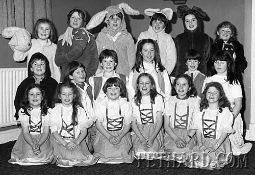 "Hogan Musical Society ""Old King Cole' Childrens' chorus group January 1986. Back L to R:  Jennifer Fogarty, Belinda McCormack, Elizabeth Burke, Nicola O'Riordan, Marie Cloonan, Laura Doyle. Middle L to R: Kevin Bourke, Niamh Ryan, Edel Fogarty, Lorraine Treacy, Patricia Purcell, Mia Teacy. Front L to R: Lisa McCormack, Vicki Roche, Lee-Ann Burke, Patricia Morrissey, Aine Doocey and Olivia Phelan."