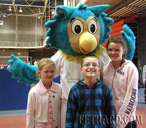 Sally Harry and Katie Butler photographed with 'Oltan the Owl',  the HSE Community Games mascot, at the recent Munster Community Games finals in University of Limerick.