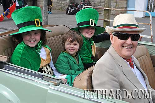 Noel Whyte driving L to R: Katie, Paddy and Lucy Whyte from Fethard in the St. Patrick's Day Parade in Clonmel