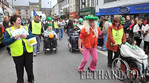 John Ryan leading the Tipperary branch of the Irish Wheelchair Association's entry who are celebrating 50 years.