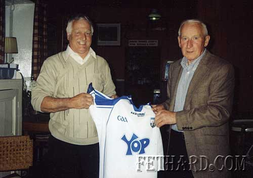Timmy Ryan, who recently retired after 42 years service with Glanbia – Avonmore Creameries, is photographed above being presented with a Waterford jersy from Willie Morrissey, ex-manager Springmount branch, another true blue!