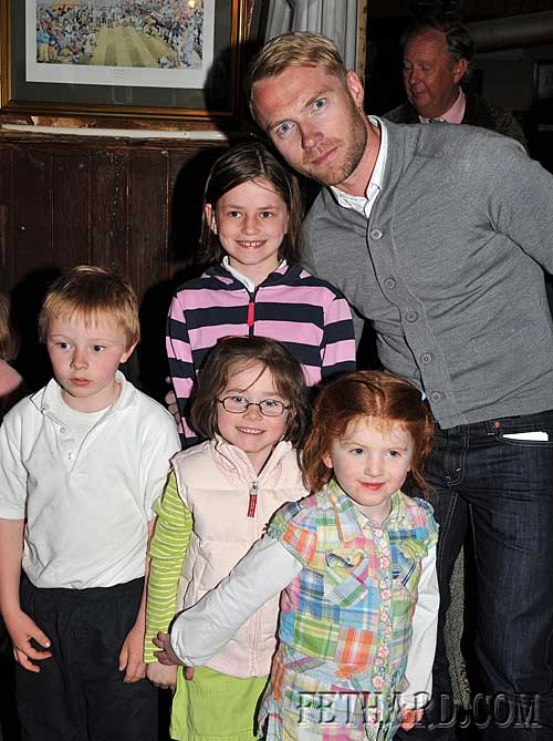 Ronan Keating photographed with some young local fans at McCarthy's Fethard