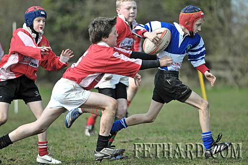 Fethard's Matthew Lynch gets ahead of the Cashel players in their under-12 match on Sunday 21st March.