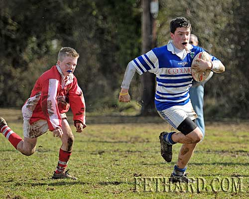 Adam Fitzgerald powers toward the line to score a try for Fethard in their 10-point win over Cashel.