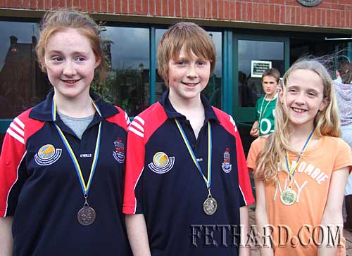 Medal winners at Co Tipperary Community Games Swimming Finals. L to R:  Zara Hogan (bronze), Isaac Hogan (gold) and Zoë Stokes (gold).