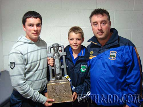 Adam Fitzgerald and Joedy Sheehan who earlier in the day helped Fethard to Reach the County U-14 C Hurling final photographed with Tipperary's team doctor, Peter Merchant, holding the All Ireland U21 Hurling Trophy won by Tipperary, shortly after the game.