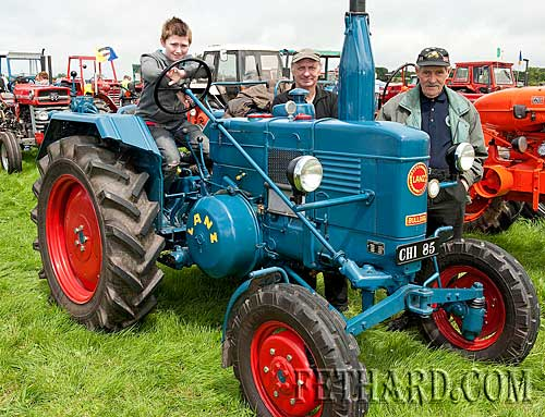 Coolmoyne and Moyglass Vintage Club Family Day. 1954 Lanz Bulldog. L to R: James Carroll, Seamus Carroll and Seamus Kirwan