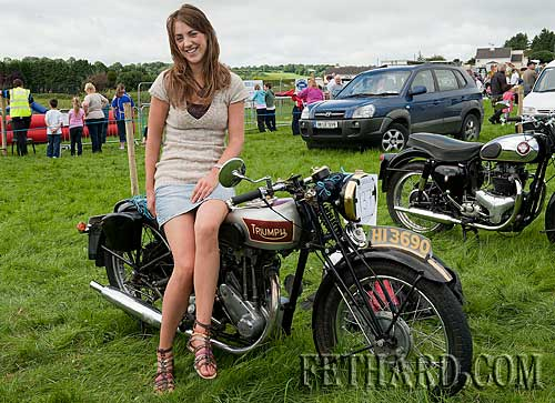 Suzanne Byrne sitting on her fathers 1936 Triumph Herald, restored by her father Philip 26 years ago. This model produced by triumph during the thirties disappeared after 1939 at the outbreak of war. Philips bike is thought to be the only one in Ireland.