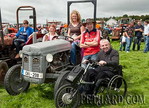 Fr. Michael Barry with some friends enjoying the sun at Coolmoyne and Moyglass Vintage Club Family Day