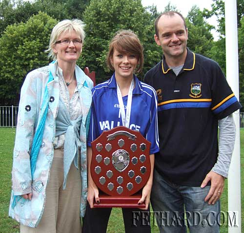Lucy Butler photographed with parents Alice and Kieran, holding the 'Tom Butler Shield' which was presented to the Munster Council many years ago by her grandfather, Tom Butler, Coolanure, Fethard.