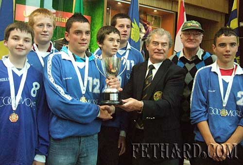 Fethard Boys U-16 volleyball team, winners of gold medals at HSE Community Games Munster Finals, being presented with the Sean Murphy Mohawk Cup by Tony Lee Director of HSE National Community Games. L to R Cormac Horan, Eoghain Hurley, Adam Fitzgerald (captain), Niall Doocey, Cathal Hurley, Tony Lee,  Denis Burke (manager) and Dion Butler. Also on the team is Ronan Fitzgerald.