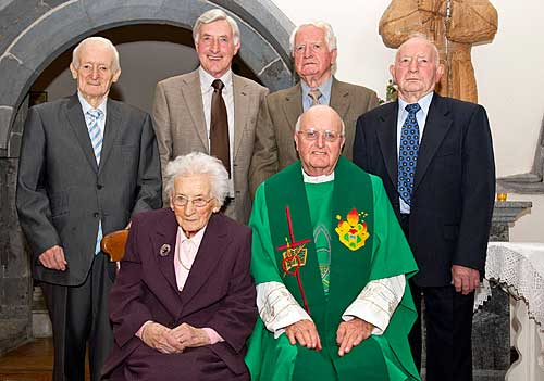 Fr. Joe Walsh and his family photographed at this Golden Jubilee in the Augustinian Abbey Back L to R: Brothers Michael, Christy, John and Jimmy Walsh. Front L to R: Peg O'Dea (sister) and Fr. Joe Walsh OSA.