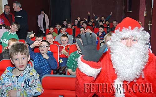 Santa settles in to watch a movie with some of the kids from the Fethard & District Rugby Club at their Christmas Party in the Youth Centre.