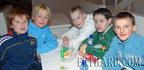 L to R: Joe Carroll, Christian Casey, Andrew Phelan, Luke Grant and Pierce Blackmore take a snack break during the Rugby Club Party at Fethard Youth Centre.