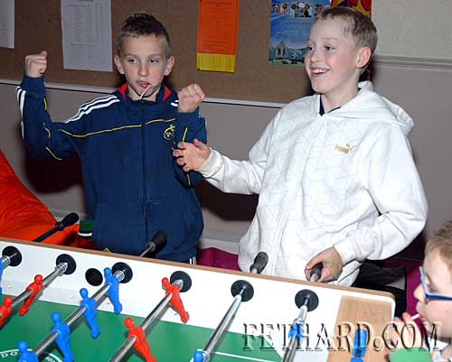 Matthew Lynch and Andrew Phelan celebrate their win on the table football at the Rugby Club Party at Fethard Youth Centre