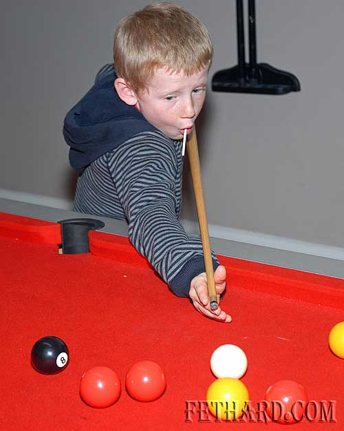 Gavin Ryan lines up a shot on the pool table at the Rugby Club Party held at Fethard Youth Centre