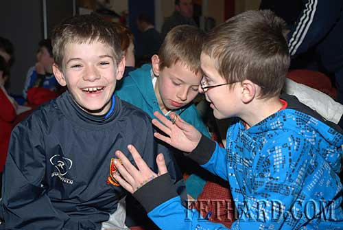 Harry Butler sees the funny side of Mark Heffernan, with their table quiz team-mate James O'Connell in the background at the Rugby Club Party at Fethard Youth Centre
