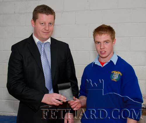 Mr John Cummins (teacher) presented a Special Achievement award for excellence in woodwork to Michael McCarthy