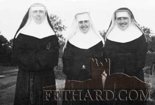 This photo was taken at Blue Point, New York, on the day that Nuala (Philomena) O'Brien received the Habit (we called it 'Clothing Day'). The three together from left are Kathleen O'Brien (Evangelist), Nuala O'Brien and Cissie Power, their first cousin. Her mother (O'Brien) was married to Will Power a baker at Coffeys. They lived at one time in the Valley, then on the Green in the house where Billy Kenny now lives and later moved down to the Convent Lodge. Cissie was a big friend and classmate of Mai Kevin.