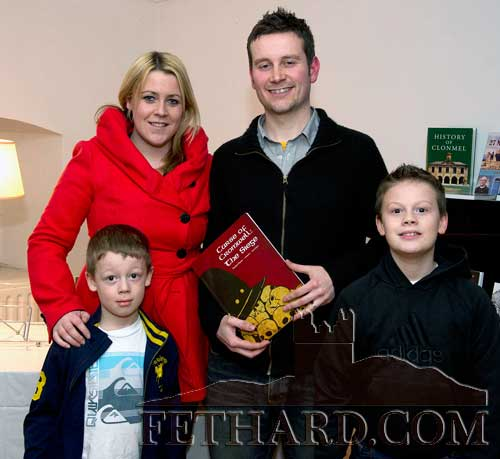 Waterford city illustrator, Lee Grace, photographed at the presentation of Fethard Historical Society's 'Tipperariana Book of the Year' award in the Abymill Theatre on 28th January. The winning book 'The Curse of Cromwell – The Siege' was published by Dermot Poyntz and illustrated by Lee. L to R: Adam Kelly, Denise Grace, Lee Grace and Dean Kelly.