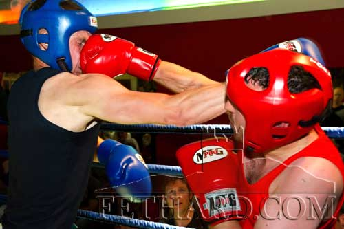 Matthew Tynan lands a straight right on Shane Kavanagh during their match at the Boxing Night Fundraiser.
