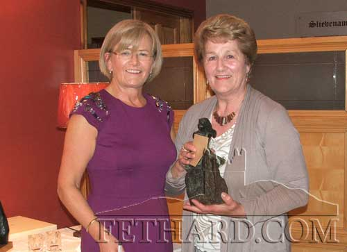 Carmel Condon (left) presenting the 'Player of the Year' prize to Nell Broderick