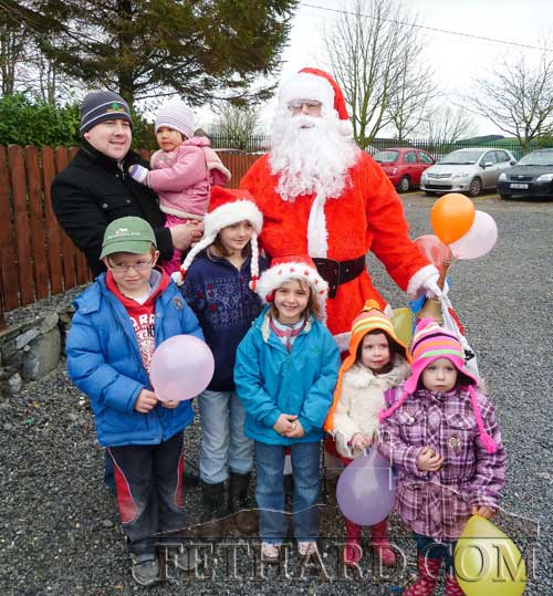 Cathal Brett and some local children speaking to Santa at Fethard Car Boot Sale.