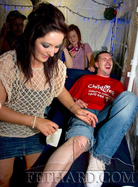 Matt Grant having his legs shaved by Niamh White in aid of Childline at The Castle Inn