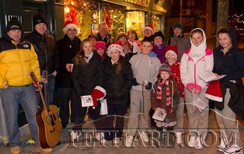 Photographed above are some of the children and adults that braved the cold weather and turned out for the Annual Christmas Carols on the streets of Fethard in aid of the CRC 'Santa Bear Appeal' on Thursday 23rd December.