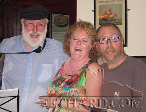 Monica (Kearney) McCahery, home on holiday from Manchester, is photographed with 'Fiddlers Green' last weekend in Lonergan's Bar. L to R: Danny Carthy, Monica McCahery and John Deego Kid